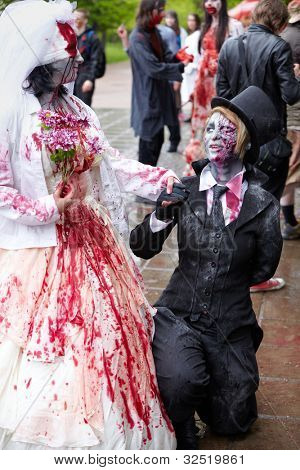 MOSCOW - MAY 14: Bride and groom zombie at the Zombie Walk on Old Arbat, May 14, 2011, Moscow, Russia.