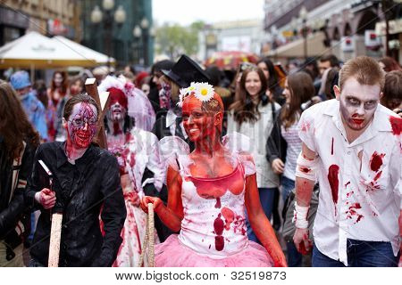 MOSCOW - MAY 14: Unidentified lauhging participants of Zombie Walk on Old Arbat, May 14, 2011, Moscow, Russia.