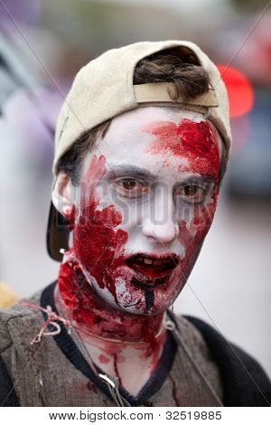 MOSCOW - MAY 14: Unidentified made-up participant of Zombie Walk on Old Arbat in the baseball cap, wearing backwards, close-up, May 14, 2011, Moscow, Russia.