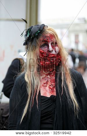 MOSCOW - MAY 14: Unidentified made-up female participant with mutilated face in mourning dress at Zombie Parade on Old Arbat, May 14, 2011, Moscow, Russia.