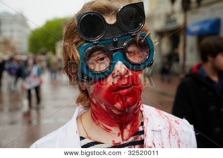 MOSCOW - MAY 14: Unidentified participant in the welder's glasses and with bloody face and throat at Zombie Parade on Old Arbat close-up, May 14, 2011, Moscow, Russia.