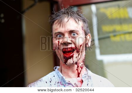MOSCOW - MAY 14: Unidentified participant of Zombie Walk on Old Arbat shows bloody teeth, May 14, 2011, Moscow, Russia.