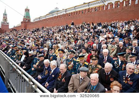 MOSCOW - MAY 9: World War II veterans sit on the podium near the Kremlin Wall and watch the parade on Victory Day celebration on Red Square, May 9, 2011, Moscow, Russia.