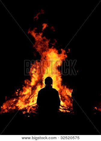 Young Woman In Front Of Bonfire