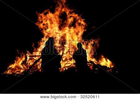 Persons In Front Of Bonfire