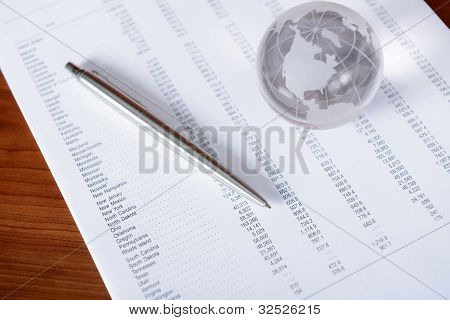 Business Papers With Glass Globe