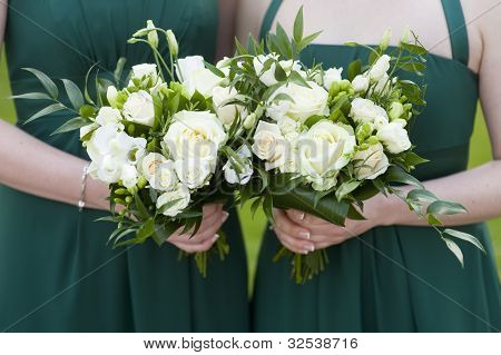 Bridesmaids Hold Flowers