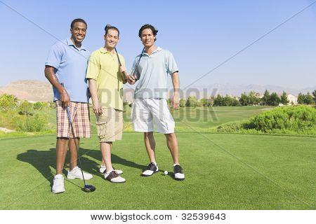 Portrait of three men on golf course