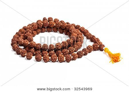 Buddhist or Hinduist Japa mala (prayer beads) made of rudraksha isolated