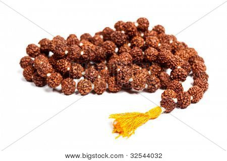Buddhist or Hinduist Japa mala (prayer beads) made of rudraksha isolated