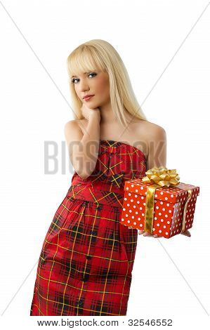 Beautiful Young Blonde Girl Holding Christmas Gift In Red Dress On White Background