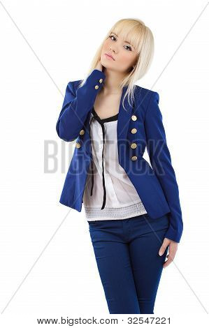 Beautiful Young Blonde Girl In Blue Pants And Jacket Posing