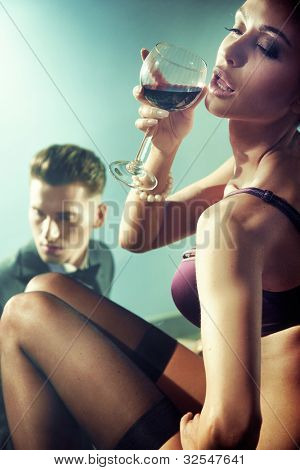 Sexy nude woman with glass of wine