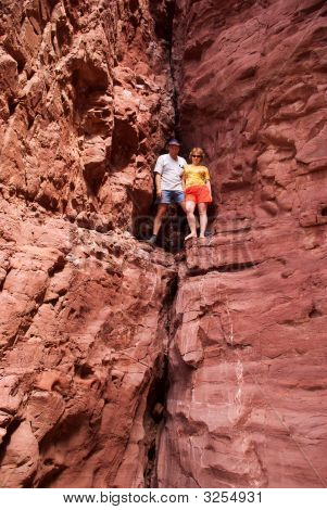 Couple Climbing In Red Rocks