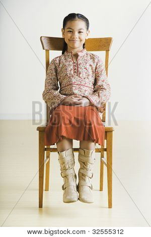 Portrait of Pacific Islander girl sitting in chair