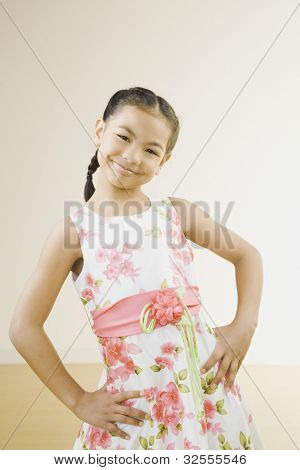 Portrait of Pacific Islander girl with hands on hips