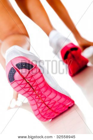 Female athlete racing focus on shoes - isolated over white