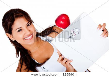 Woman on a diet to loose weight holding a scale - isolated over white