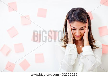 Busy business woman looking desperate with memo notes