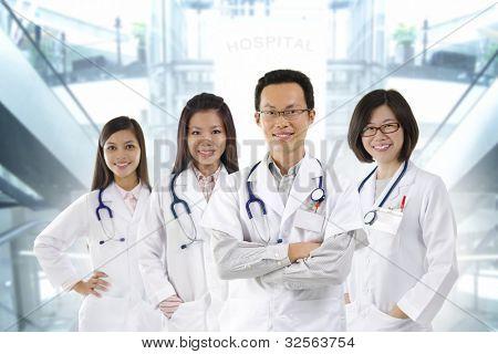 Asian medical team standing inside hospital building