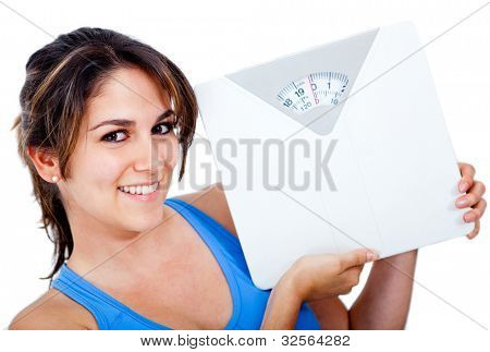 Happy woman holding a scale - weight loss concepts