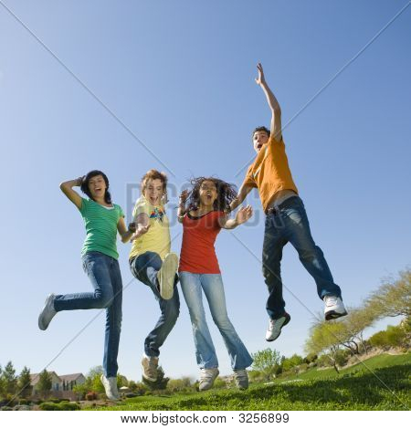 Happy Teens Jump In Air