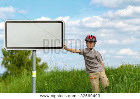 Boy Cyclist Leaning On Blank Sign