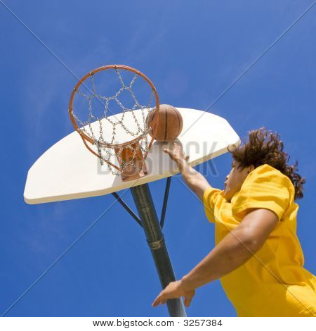 Basketball Player Jumps And Shoots