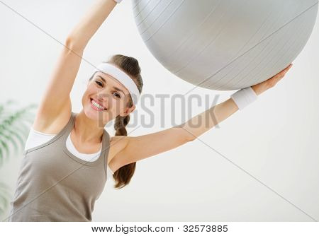 Smiling Slim Woman Making Exercises With Fitness Ball