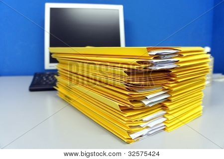 Yellow Folders With Paper Documents
