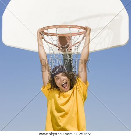 Boy Hangs From Hoop