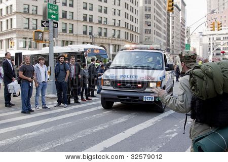 NEW YORK - MAY 1: A protester acknowledges taunts from a man claiming to be part of the one percent during May Day protests on May 1, 2012 in New York, NY.