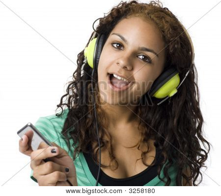 Girl Listens With Headphones