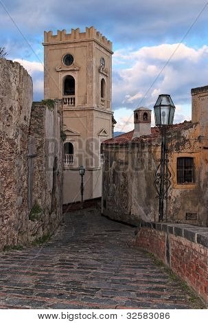 Paved medieval street with church belfry in Savoca village,  Sicily, Italy