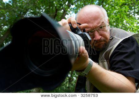 Photographer With Telescopic Lens