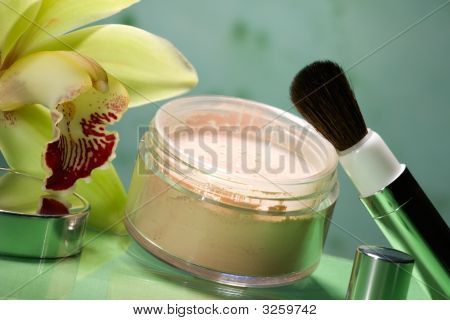 Face Powder And Orchid Flower