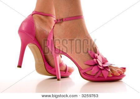 A Woman In Pink High Heel Shoes