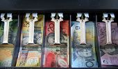 image of cash register  - Open cash drawer filled with Australian currency notes - JPG