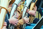 Close - Up Of Musicians Playing In Outerwear On The Street Hands On The Keys Of A Wind Instrument. B poster