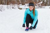 Winter Sports Fashion Concept. Woman Tying Sport Fitness Shoes In Snow, Footwear For Workout Outside poster