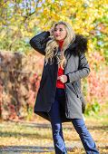 Woman Long Blonde Hair Wear Stylish Outfit With Parka. Create Fall Outfit To Feel Comfortable And Pr poster