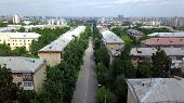 Top View Of Straight Road Of Residential Area Of City. Stock Footage. Road With Cars Directly Passes poster