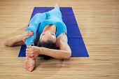 Young And Beautiful Woman Doing Stretching And Yoga Postures Asana Takes On Yoga Mats On The Wooden  poster