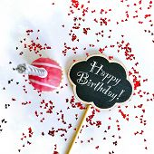 Colorful Happy Birthday Cupcakes With Candles With Compliments. Birthday Cupcake And Black Board Wit poster