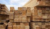 Lumber Warehouse. Wood Planks And Timber Stacked In Stacks Outdoors poster