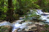Erawan Waterfall Idyllic In Rain Forest  And Is Deep Forest Of Kanchanaburi Province, Thailand poster