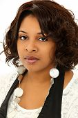 foto of middle-age  - Beautiful Serious Black Woman Over White Background in Casual Clothing - JPG