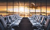 Empty Airport Terminal Lounge With Airplane On Background. Modern Airport Waiting Area With Flyinf A poster