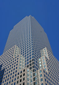 foto of modern building  - manhattan harbor side skyscraper financial district against a blue sky