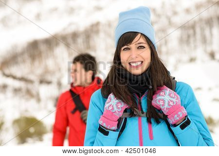Couple Hiking On Winter Mountain